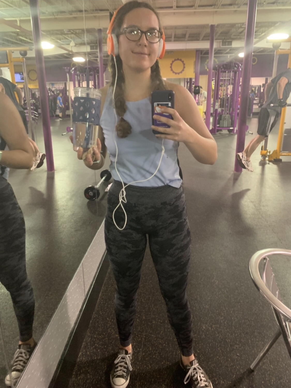 Senior Lucy Pappa snaps a picture of herself at Planet Fitness. Pappa is apart of Planet Fitness' summer teen program.