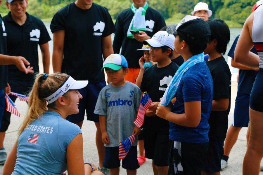 "Senior Aidan Wrenn-Walz talks with a group of elementary school kids from Kitakata City, Fukushima, the host city for the U.S. for the upcoming 2020 Olympic Games. The US team had the opportunity to row with the kids in a cultural exchange event. ""I still keep in contact with one of the girls via email and I hope to visit again someday."" Wrenn-Walz said."