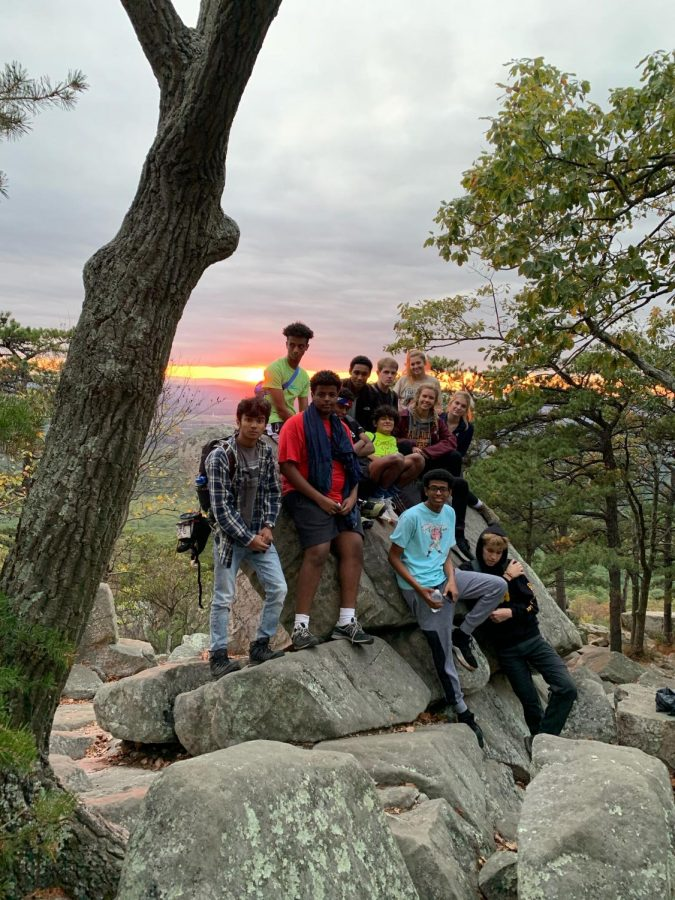 Outdoor Club members sit on a rock overlooking the Blue Ridge Mountains on Sugarloaf Mountain, Maryland. Hiking Sugarloaf was the clubs first outdoor activity.