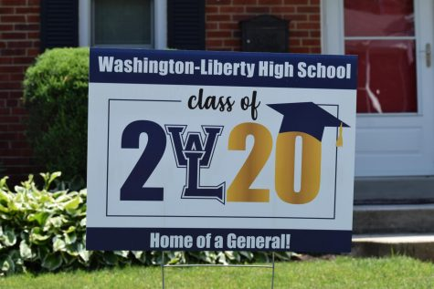 An Arlington family displays a yard sign to honor their senior. The plan to distribute the signs was devised by the administration after seeing the idea implemented for other schools in Arlington.