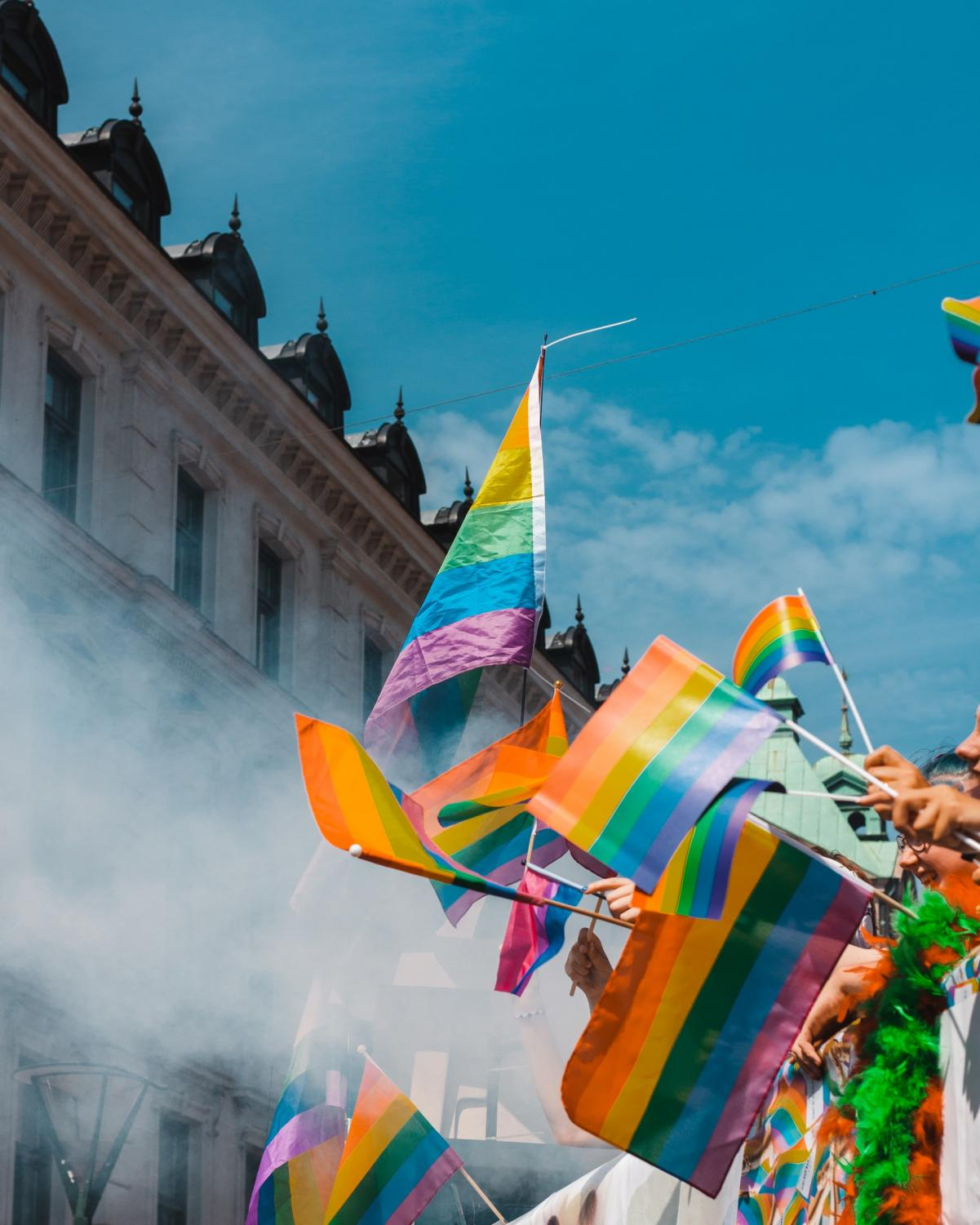 People hold rainbow flags at a pride parade. Last year, both Arlington and Alexandria received a perfect Municipal Equality Index score for LGBTQ inclusion.