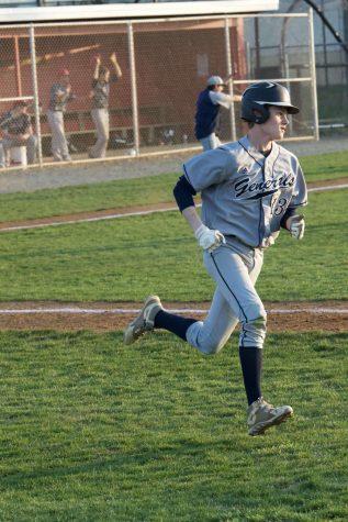 Andrew Bolfek, number 13, runs around the bases at lightning speed