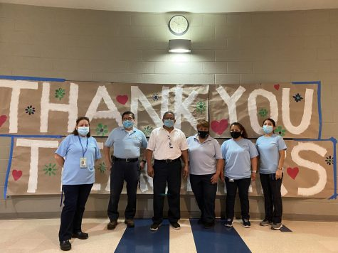 The custodial staff stands for a photo. They have been extremely helpful and necessary during this difficult time.
