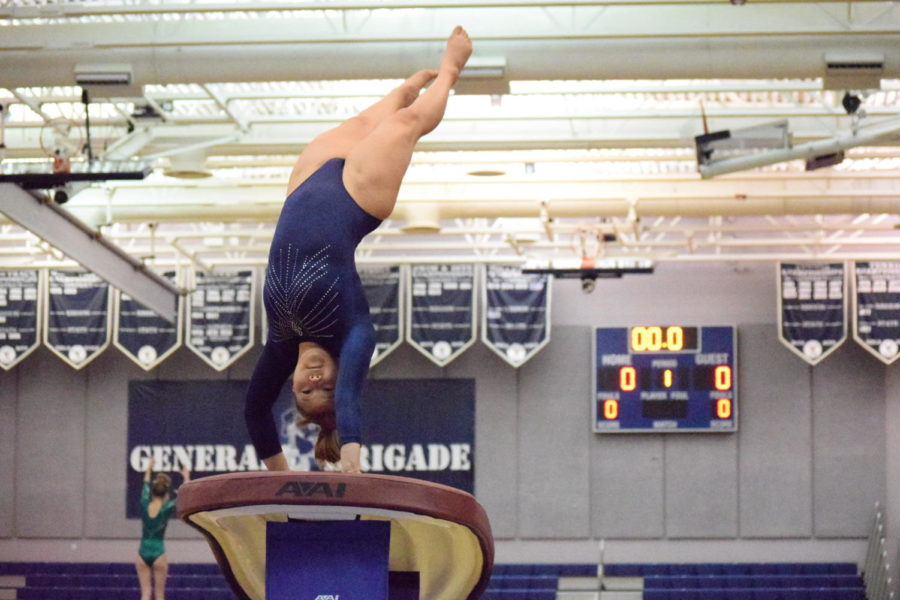 A student on our gymnastics team mid-flip. Some gymnasts suffer from mental blocks which stop them from completing some moves.